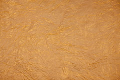 Christmas golden background.  paper texture. Royalty Free Stock Photo