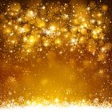 Christmas golden background. With snowflakes and snow Royalty Free Stock Images