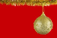 Christmas golden ball. On a red background Royalty Free Stock Photo