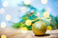 Christmas golden ball on abstract background copyspace stock image
