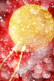 Christmas Golden Ball Close Up over Red stock photo