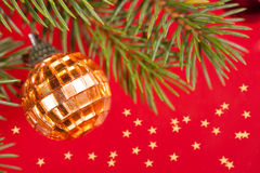 Christmas golden ball on red Royalty Free Stock Photo