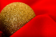 Christmas golden ball on a red. macro Stock Images