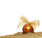Christmas golden ball. With ribbon on white background royalty free stock photography