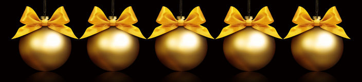 Christmas golden balls hanging in black background Stock Image