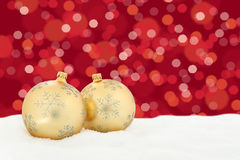 Christmas golden balls red background decoration with snow light Stock Image