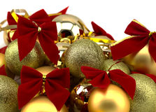 Christmas golden balls with red ribbons on a white background Stock Photography