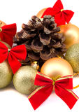 Christmas golden balls with red ribbons on a white background Royalty Free Stock Photography