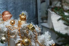 Christmas golden balls, toys and white garland decorations stock photos