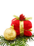Christmas golden bauble and gifts. Celebrating Christmas with gifts and golden bauble. Isolated on white background stock photos