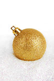 Christmas golden bauble Stock Photo