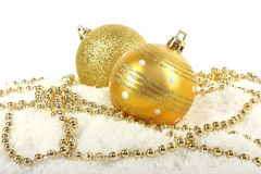 Christmas golden baubles with beads Stock Photo