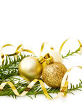 Christmas golden baubles and pine tree. Celebrating Christmas with pine tree branch and golden baubles. Isolated on white background Royalty Free Stock Photography