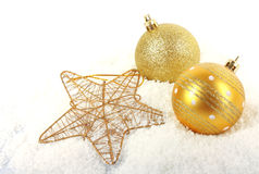 Christmas golden baubles with star Stock Photo