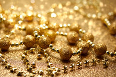 Christmas golden beads Royalty Free Stock Photography