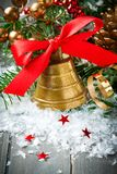 Christmas golden bell with red satin ribbon bow Stock Image