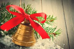 Christmas golden bell with red satin ribbon bow Stock Images