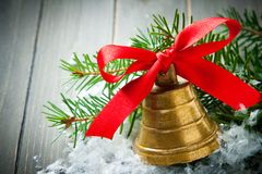 Christmas golden bell with red satin ribbon bow Royalty Free Stock Photos