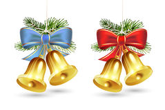 Christmas golden bells. With red and blue bows on white background Stock Image