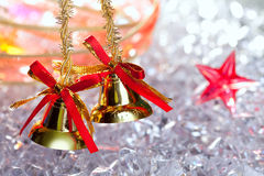 Christmas golden bells with red ribbon Royalty Free Stock Photo