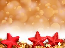 Christmas golden bokeh background with red star decorations royalty free stock photography