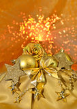Christmas golden bolls, stars on light background Royalty Free Stock Images