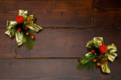 Christmas golden bowknot. Decoration for home on the wooden table in a form of Christmas golden bowknot royalty free stock images