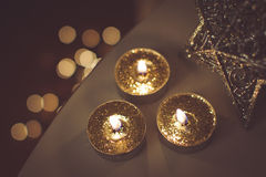 Christmas golden candles Stock Photo