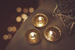 Christmas golden candles Stock Photo