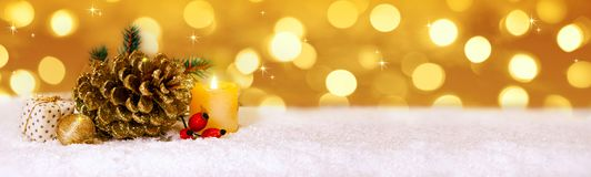 Christmas golden decoration and Advent candle. Royalty Free Stock Photo