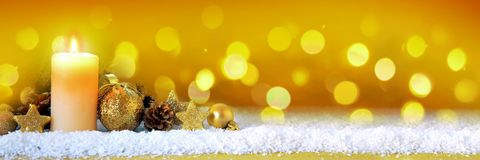 Christmas golden decoration and Advent candle. Stock Image