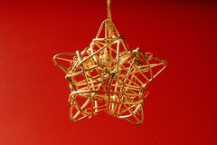Christmas golden decoration with gold star Royalty Free Stock Images