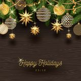 Christmas decoration and Christmas tree branches on a wooden background. Stock Photos