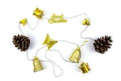 Christmas golden decorations on white background. Stock Photo