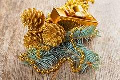 Christmas golden decorations on wooden background Stock Images