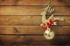 Christmas golden deer ornament. On wooden background royalty free stock image