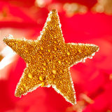 Christmas golden drops star in red Stock Photography