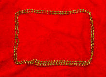 Christmas golden frame on red background Royalty Free Stock Photography