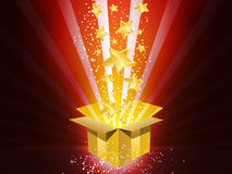 Christmas Golden Gift Box with Stars. Explosion Stock Photo