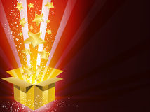 Christmas Golden Gift Box with Stars. Background Royalty Free Stock Photo