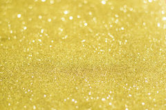 Christmas Golden Glittering background.Holiday Gold abstract tex stock photo