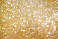 Christmas golden glow bokeh light blur Background Royalty Free Stock Photo