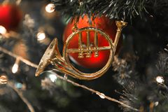 Christmas golden hanging on a beautiful Christmas tree surrounded by red shinning ball. S Royalty Free Stock Photography
