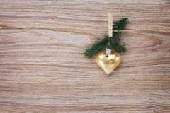 Christmas golden heart with evergreen  twig Stock Photo