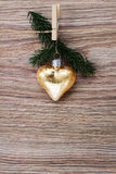 Christmas golden heart with green  twig Stock Photos