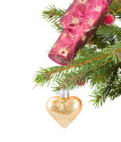 Christmas golden heart hanging on fir tree Royalty Free Stock Photo