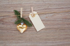 Christmas golden heart with tag Royalty Free Stock Images