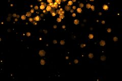 Christmas golden light shine particles bokeh loopable from top on black background, holiday congratulation greeting party happy ne Stock Images