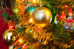 Christmas golden lights and Christmas balls and decoration detai Stock Photos