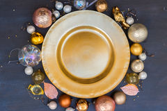 Christmas golden plate. Christmas empty golden plate with gold balls decorations Royalty Free Stock Image